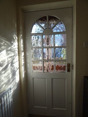 The front door's glass makes interesting patterns with the morning sunlight.