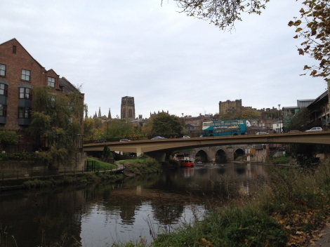 The Elvet Bridge is the one beyond the roadway bridge.  The Cathedral, the Castle, and a Double Decker Bus greet us on our morning commute.