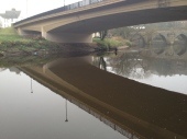 A lone rower practices on the River Wear in the early fog.