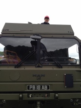 Joshua takes a go in the cab of one of the Army's trucks.