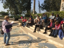 Sue reading from the Sermon on the Mount at the Mount of Beatitudes.