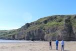 The cliffs meet the beach.